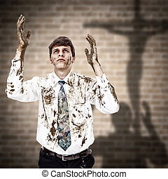 Young man coming to the Jesus cross with his dirty hands and clothes