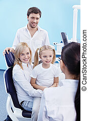 At the Dentist - Young family with a child in the dental...