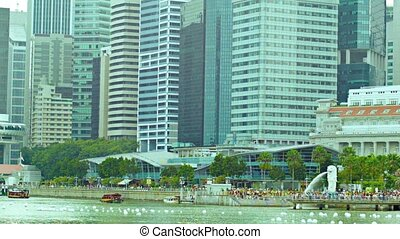 At the foot of skyscrapers in central Singapore