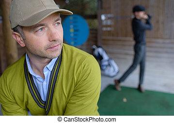 at the golf range