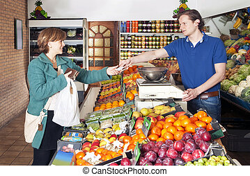 At the Greengrocer - Woman shopping for fresh food and...