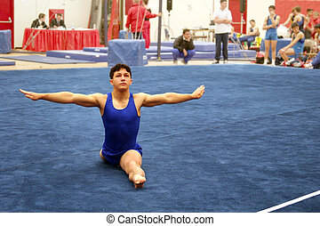 At the gym - Young gymnast competing on floor