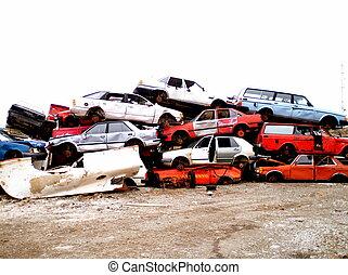 At the junk yard - a heap of wrecked cars at a junk yard
