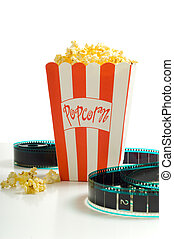 A box of popcorn with a stip of 35mm film on a white background, symbols of the entertainment industry
