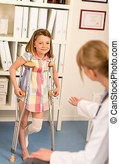 At the pediatrician little girl with crutches