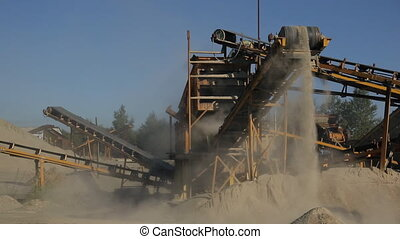 At the plant at high conveyor moves the sand and drops down.