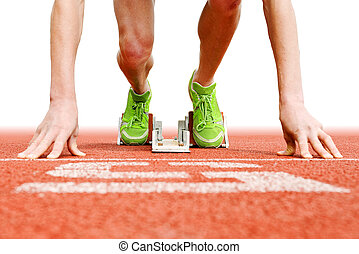 At the Starting blocks - Athlete in the starting blocks,...