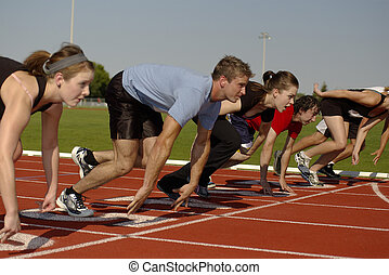 At the Starting Line - A group of young adults at the...