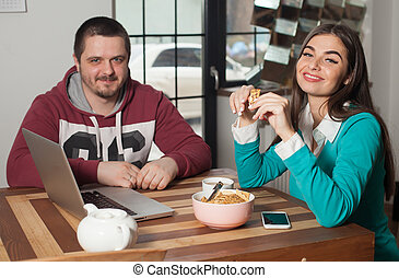 At the table are man and woman