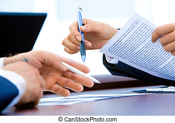 At work time - Image of business people�s hands during...