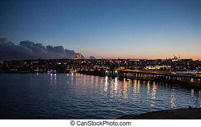 Ataturk bridge on Golden Horn at night on display