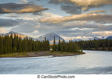Athabasca River at Sunset with Rocky Mountains in Background...