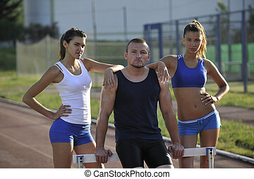 atheltics team - group op athletics people standing and...