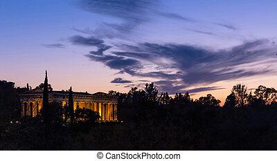 Athens Greece. Hephaestus temple illuminated, at sunset,...