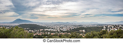 Athens Greece panorama. Aerial view of Athens city from Penteli mount, cloudy winter day.