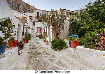 Athens. Plaka area. - Traditional white houses on a narrow...