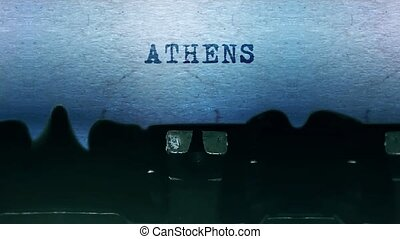 ATHENS Word closeup Being Typing and Centered on a Sheet of paper on old vintage Typewriter mechanical 4k Footage Background Animation.