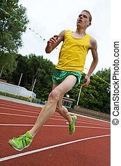 athlet, mitten in der luft, rennender