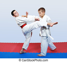 Athlete a punch in response to kick - An athlete with a ...