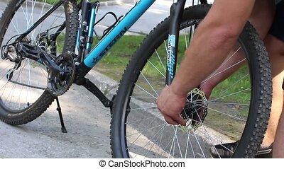 athlete bicycle wheel mounts to the bike ride