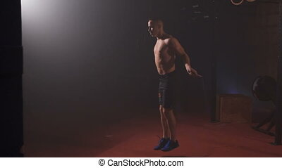 Athlete do exercise on a skipping rope.