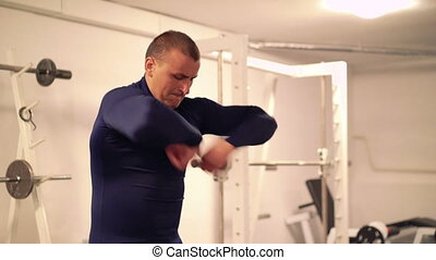 Athlete doing exercise for arms and hands in the modern gym. 4k