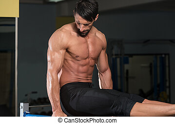 Athlete Doing Heavy Weight Exercise On Parallel Bars - Fit ...