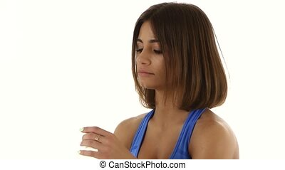 Athlete drinks water during a workout. Close up. White - ...