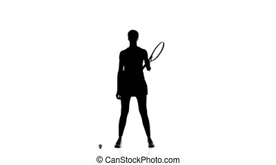 Athlete holding a tennis racket and ball fills it. Silhouette