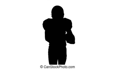 Athlete holds the ball in his hands and running in gear....