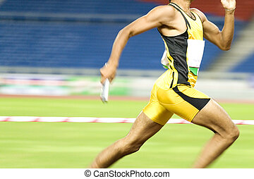 Athlete in Action - Image of a 4x400 meters athlete in...