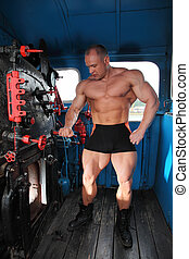 athlete in locomotive cabin full body with open furnace