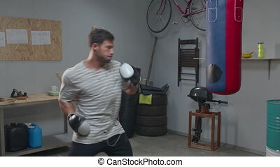 Athlete is practicing punches on a punching bag