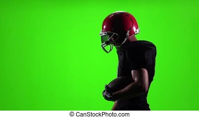 Athlete is with the ball in his hands. Slow motion, side view