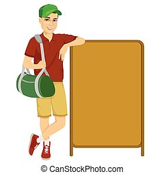 athlete leaning against a red blank board