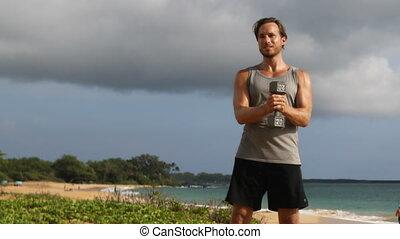 Athlete man exercising dumbbells workout doing Standing ...