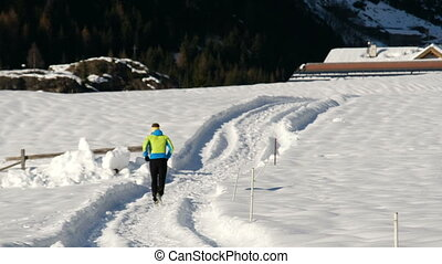 athlete man running on the snow