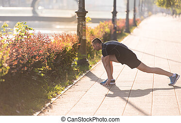 athlete man warming up and stretching