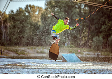 Athlete on a board on the lake.