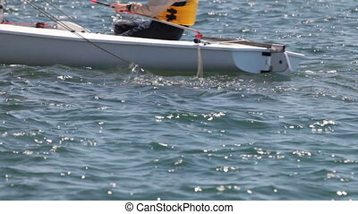 athlete on sailing boat