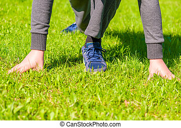 Athlete ready to run on the green lawn