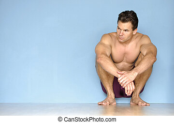 Athlete resting - Handsome male athlete takes a break from...
