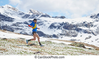 Athlete Runner during a mountain workout in spring