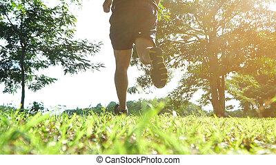 Athlete runner feet running on trail.