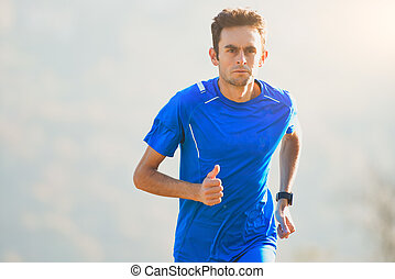 Athlete running in the mountains of the Italian national team in training