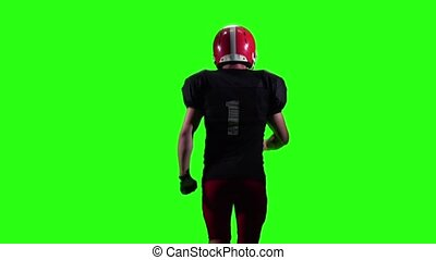 Athlete running in the red outfit. Slow motion, green screen