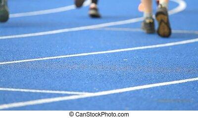 Athlete running on the stadium - Athlete running on the blue...