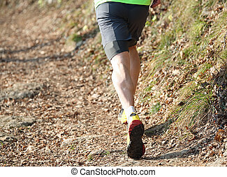 athlete running on the trail