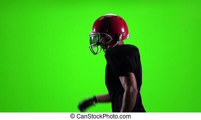 Athlete runs and throws the ball. Slow motion. Green screen