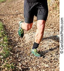 Athlete runs fast during the triathlon race
